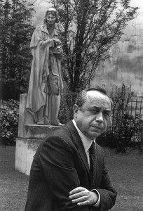 FRANCE. Paris. Italian writer Leonardo SCIASCIA standing in front of a statue of French writer and philosopher VOLTAIRE in rue de Seine.